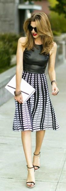 Street style | Black leather top and printed skirt.