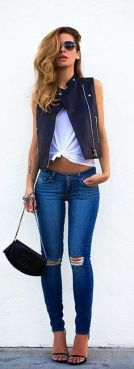 Leather Vest + Blue ripped skinnies jeans.